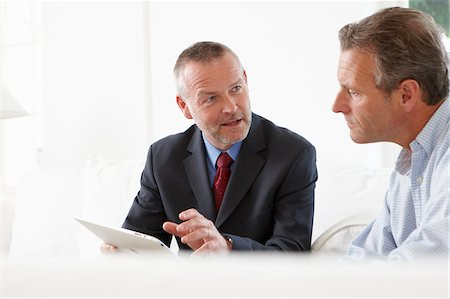 Financial advisor talking to customer Stock Photo - Premium Royalty-Free, Code: 635-05652330