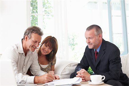 Couple signing contract with financial advisor Stock Photo - Premium Royalty-Free, Code: 635-05652348