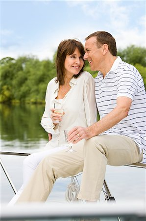 Couple sitting on boat drinking together Stock Photo - Premium Royalty-Free, Code: 635-05652349