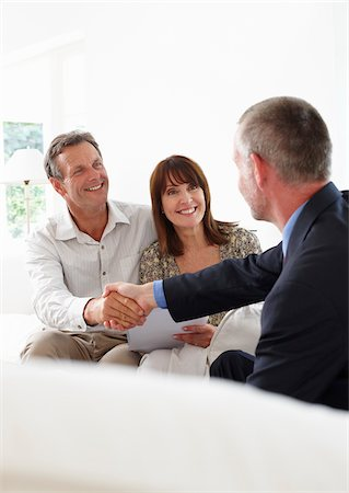 Financial advisor shaking hands with customers Stock Photo - Premium Royalty-Free, Code: 635-05652340