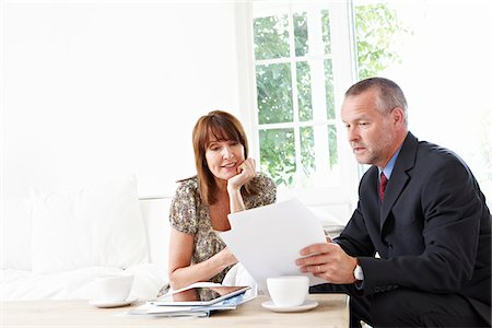 Financial advisor explaining paperwork to customer Stock Photo - Premium Royalty-Free, Code: 635-05652379