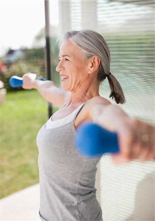 Woman exercising outdoors Stock Photo - Premium Royalty-Free, Code: 635-05652386