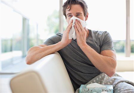 people coughing or sneezing - Sick man blowing his nose Stock Photo - Premium Royalty-Free, Code: 635-05652383