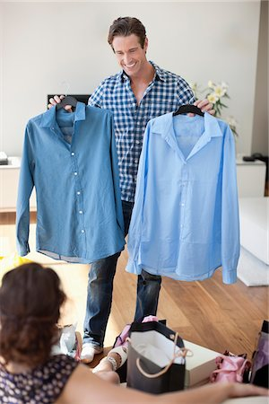 Man showing new shirts to wife Stock Photo - Premium Royalty-Free, Code: 635-05652396