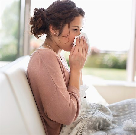 people coughing or sneezing - Sick woman blowing her nose Stock Photo - Premium Royalty-Free, Code: 635-05652410