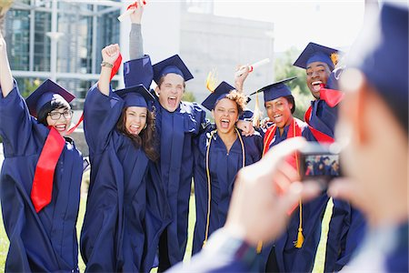 Cheering graduates taking picture of themselves Stock Photo - Premium Royalty-Free, Code: 635-05971438