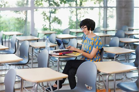 expectation - Student using laptop in classroom Stock Photo - Premium Royalty-Free, Code: 635-05971453