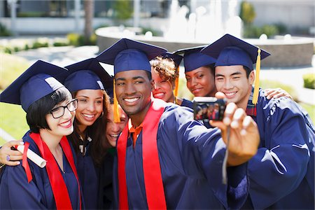 Graduates taking picture of themselves Stock Photo - Premium Royalty-Free, Code: 635-05971472