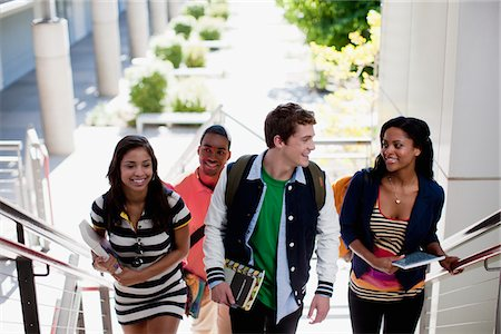 Students climbing steps together Stock Photo - Premium Royalty-Free, Code: 635-05971485