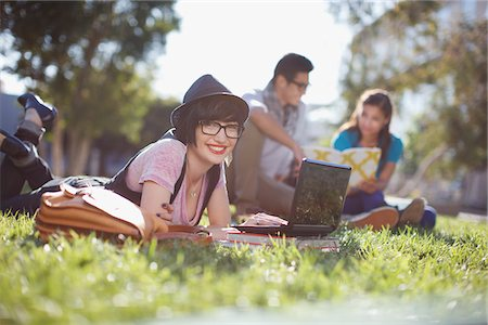Student using laptop in grass Stock Photo - Premium Royalty-Free, Code: 635-05971507