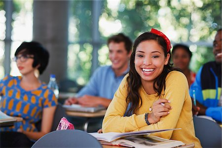 Student laughing at desk in classroom Stock Photo - Premium Royalty-Free, Code: 635-05971509