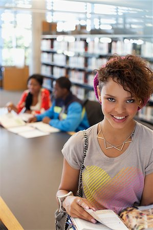 Student reading book in library Stock Photo - Premium Royalty-Free, Code: 635-05971523