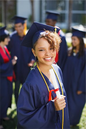 Smiling graduate holding diploma Stock Photo - Premium Royalty-Free, Code: 635-05971552