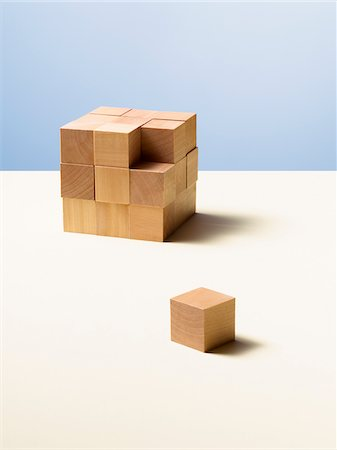 Piece of wooden cube separate from whole Stock Photo - Premium Royalty-Free, Code: 635-05971585