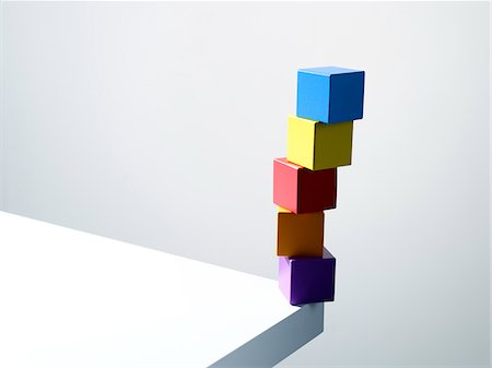 Stack of colorful cubes on table corner Stock Photo - Premium Royalty-Free, Code: 635-05971586