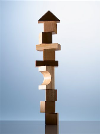 Stack of wooden blocks on table corner Stock Photo - Premium Royalty-Free, Code: 635-05971587