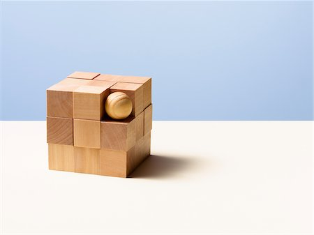 Wooden ball in cube Stock Photo - Premium Royalty-Free, Code: 635-05971588