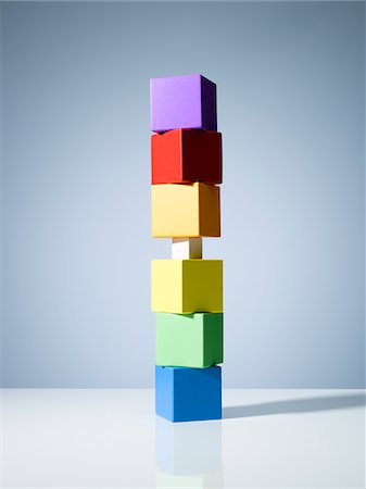 Tiny block in stack of colorful cubes Stock Photo - Premium Royalty-Free, Code: 635-05971589