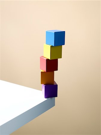 Stack of colorful cubes on table corner Stock Photo - Premium Royalty-Free, Code: 635-05971580