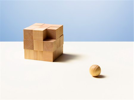Wooden ball with wooden cube Stock Photo - Premium Royalty-Free, Code: 635-05971582