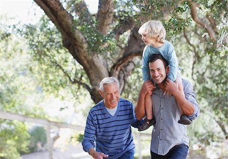 Three generations of men walking outdoors Stock Photo - Premium Royalty-Free, Code: 635-05971766