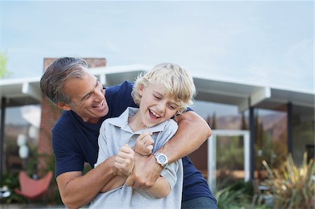 Father and son playing outdoors Stock Photo - Premium Royalty-Free, Code: 635-05971760