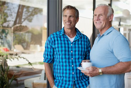 Father and son having coffee together Stock Photo - Premium Royalty-Free, Code: 635-05971763