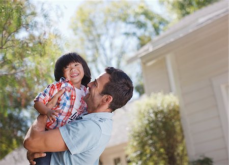 domestic life - Smiling father holding son outdoors Stock Photo - Premium Royalty-Free, Code: 635-05971791