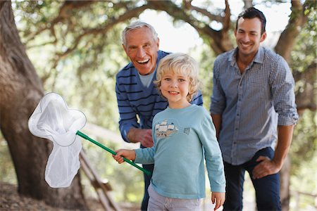 Three generations of men playing with butterfly net Stock Photo - Premium Royalty-Free, Code: 635-05971793
