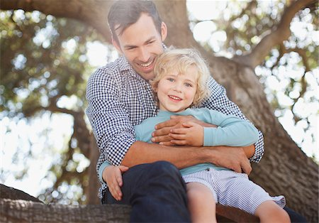 Father and son relaxing outdoors Stock Photo - Premium Royalty-Free, Code: 635-05971805