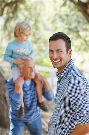 Three generations of men relaxing outdoors Stock Photo - Premium Royalty-Free, Code: 635-05971812