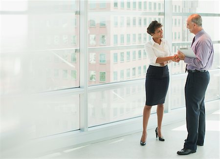 Business people shaking hands in office Stock Photo - Premium Royalty-Free, Code: 635-05971860