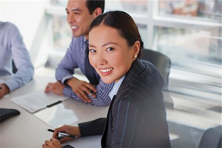 Businesswoman sitting in meeting Stock Photo - Premium Royalty-Free, Code: 635-05971861