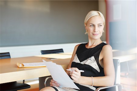 Businesswoman working in office Stock Photo - Premium Royalty-Free, Code: 635-05971871