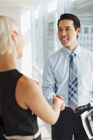Business people shaking hands in office Stock Photo - Premium Royalty-Free, Code: 635-05971898