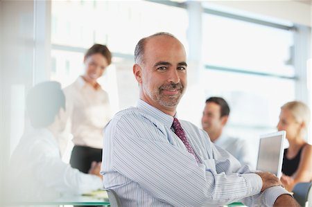 Businessman sitting in meeting Stock Photo - Premium Royalty-Free, Code: 635-05971917