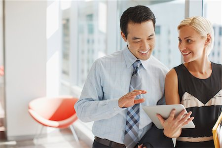Business people using tablet computer in office Stock Photo - Premium Royalty-Free, Code: 635-05971910