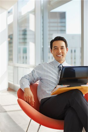 Businessman using laptop in office Stock Photo - Premium Royalty-Free, Code: 635-05971946