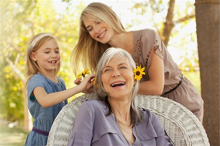 Three generations of women playing outdoors Stock Photo - Premium Royalty-Free, Code: 635-05971957
