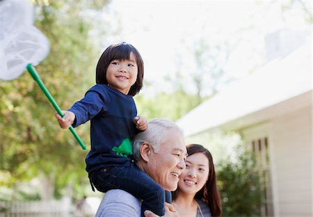 Older man carrying grandson on shoulders Stock Photo - Premium Royalty-Free, Code: 635-05971966