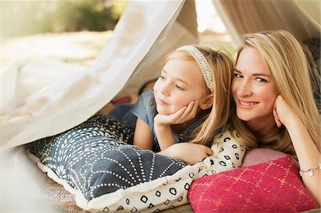 Mother and daughter laying in tent outdoors Stock Photo - Premium Royalty-Free, Code: 635-05971963