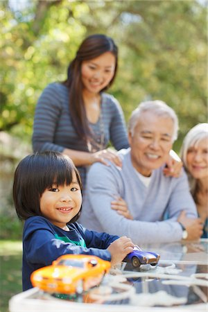 Family relaxing together in backyard Stock Photo - Premium Royalty-Free, Code: 635-05971977