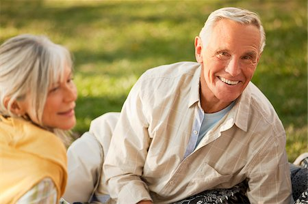 Older couple relaxing on blanket outdoors Stock Photo - Premium Royalty-Free, Code: 635-05971970