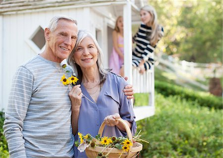 Older couple picking flowers outdoors Stock Photo - Premium Royalty-Free, Code: 635-05971997