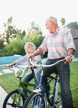 preteens pictures older men - Older man and grandson riding bicycles outdoors Stock Photo - Premium Royalty-Free, Code: 635-05972006