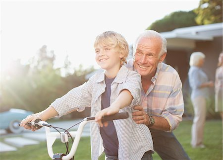 preteens pictures older men - Older man helping grandson ride bicycle Stock Photo - Premium Royalty-Free, Code: 635-05972017