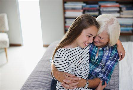 Older woman hugging granddaughter indoors Stock Photo - Premium Royalty-Free, Code: 635-05972010