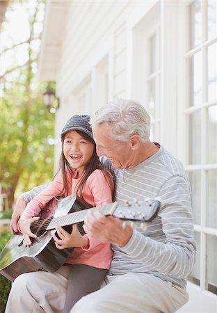 Older man and granddaughter playing guitar Stock Photo - Premium Royalty-Free, Code: 635-05972038