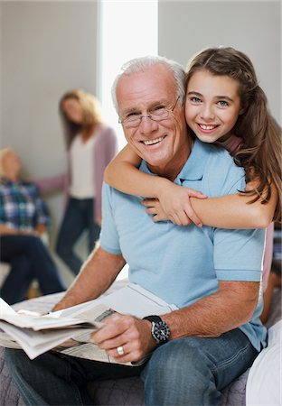 Girl hugging grandfather at home Stock Photo - Premium Royalty-Free, Code: 635-05972045