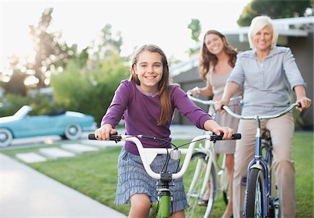 Three generations of women riding bicycles Stock Photo - Premium Royalty-Free, Code: 635-05972048